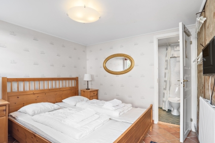 Ett av rummen i Lilla Gårdshuset med eget badrum